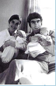 Baby AstroTwins with mom and dad.
