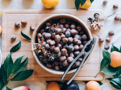 bowl of hazelnuts one of many foods to experiment with during Sagittarius season