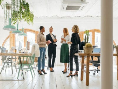 group of women at work in a modern office jupiter in capricorn