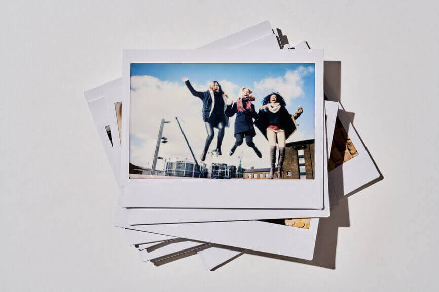 polaroid pictures in a pile images showing friends having fun