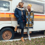 women leaning against van talking about december 2019 gemini full moon