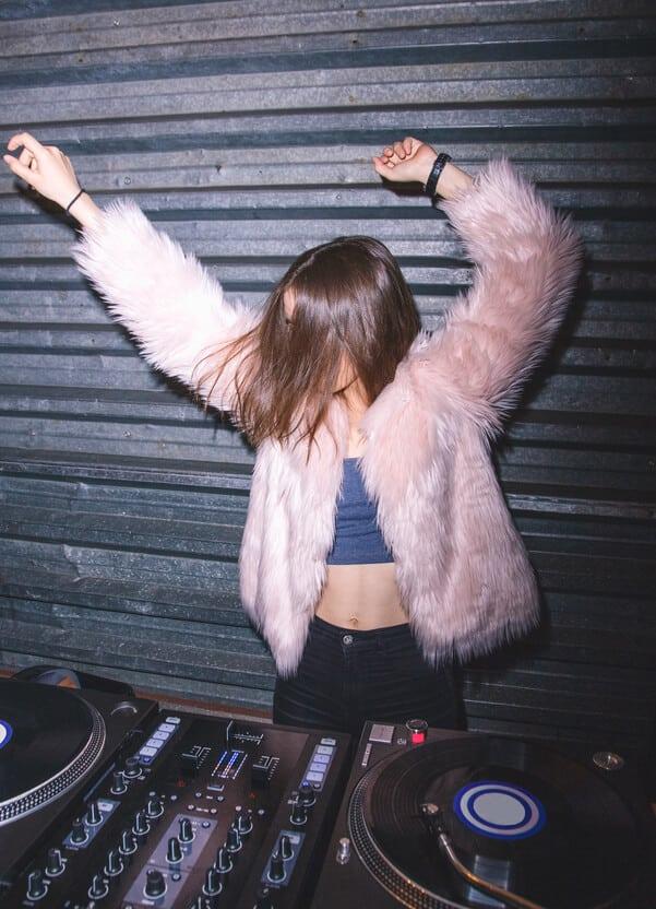 woman DJ celebrating new year's eve 2020