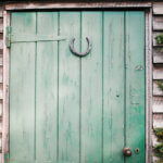 lucky horseshoe on door for 2020 St. Patrick's Day horoscope by the astrotwins on astrostyle.com