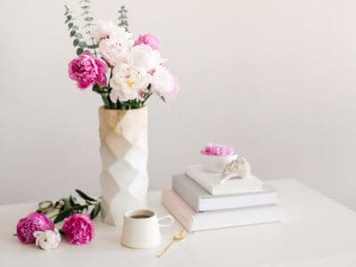 clean desk with pretty vase of flowers to show the healthy vibes of the 2020 virgo full moon